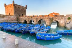 Fortress and blue fishing boats in Essaouira. Morocco Royalty Free Stock Photo