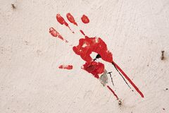 Hand print in red paint on a white wall. Essaouira, Morocco - September 2017: Hand print in red paint on a white wall royalty free stock image
