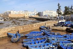 Essaouira Ramparts aerial panoramic view in Essaouira, Morocco with traditional blue fishing ships. Essaouira is a city royalty free stock photo
