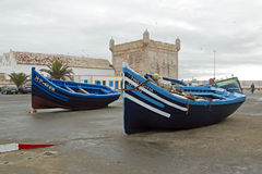 ESSAOURIA, MOROCCO - OCTOBER 25, 2013: Boats at the harbor from Royalty Free Stock Image