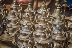 Collection of weathered metal teapots for sale on a market stall royalty free stock images