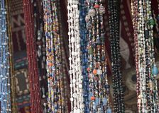 Moroccan bead stall with necklaces hung across it royalty free stock images