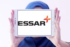 Essar Group logo. Logo of Essar Group on samsung tablet holded by arab muslim woman. Essar Global Fund Limited is an Indian conglomerate group. The Fund is a Stock Photography