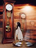 ESSE. Girl around clock, studio photo Stock Photo