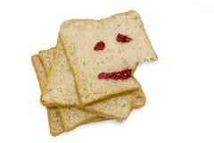 Essen des glücklichen Gesichtsbrotes lizenzfreie stockbilder