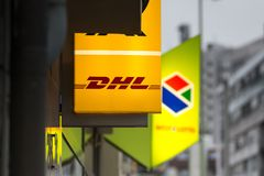 Essen, North Rhine-Westphalia/germany - 18 10 18: deutsche post dhl sign in essen germany in the evening. Essen, North Rhine-Westphalia/germany - 18 10 18: an stock photography