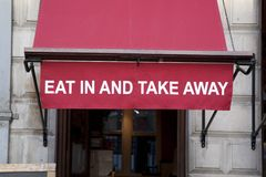 Essen Sie herein oder nehmen Sie Zeichen weg Lizenzfreie Stockbilder