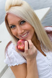 Essen von einem Apple Stockfoto