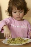 Essen von Teigwaren Stockbild