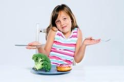 Essen von Wahlen, gesund oder ungesund Stockfotos