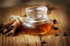 Essence Bottle and Cinnamon Stock Photos