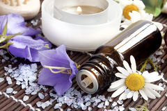Essence bottle and spa flowers Royalty Free Stock Image