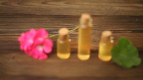 Essence of  flowers on table in beautiful glass bottle stock footage