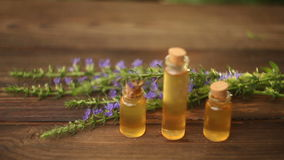 Essence of  flowers on table in beautiful bottle stock footage
