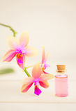 Essence of  orchid flowers on table in beautiful glass jar Stock Photo