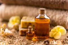Essential aroma oil. Bottles of essential aroma oil on wooden board Royalty Free Stock Photos