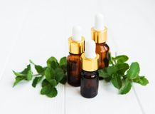 Essential aroma oil with mint. On a white wooden table Stock Images