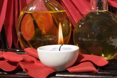 Essential body massage oils with candles Royalty Free Stock Photo