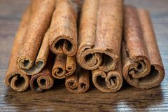 Essential cinnamon for spa, close up on wooden Stock Photo