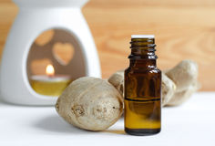Essential ginger oil. Small bottle of essential ginger oil Stock Photos