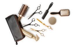 Essential hair dresser tools with leather bag on white background Stock Photo