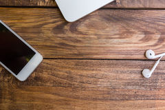 Essential items on wooden desk Royalty Free Stock Photo