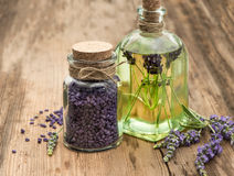 Essential lavender oil, herbal soap and bath salt. With fresh flowers on wooden background. selective focus Royalty Free Stock Photography