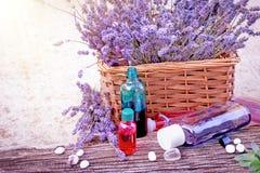 Essential Lavender oil, lavender oil and spa stones Stock Photos