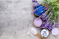 Essential lavender salt with flowers top view. Royalty Free Stock Image