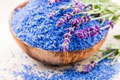 Essential lavender salt with flowers top view royalty free stock photos