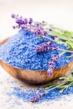 Essential lavender salt with flowers top view stock image