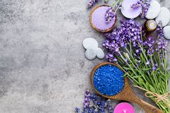 Essential lavender salt with flowers top view stock photography