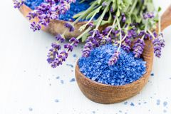 Essential lavender salt with flowers top view royalty free stock photo