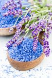 Essential lavender salt with flowers top view. Stock Image