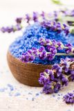Essential lavender salt with flowers top view. Royalty Free Stock Photography