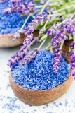 Essential lavender salt with flowers top view royalty free stock image