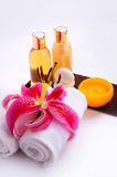 Essential Massage Setting. Spa elements with essential massage oils incense sticks and stones Stock Image