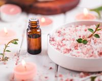 Essential oil for aromatherapy, flowers, handmade soap, himalayan salt. stock photos