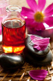 Essential oil for aromatherapy and Zen Stones Royalty Free Stock Photos