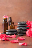 Essential oil azalea flowers black massage stones Royalty Free Stock Photography