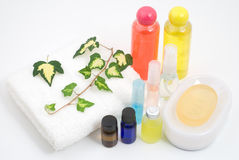 Essential oil and bath set. With ivy on white background Stock Photo