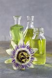 Essential oil bottles with a passion flower Stock Images