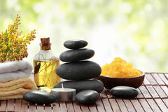 Essential oil , candle, towel and stones for teraphy Stock Photography
