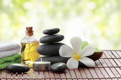 Essential oil , candle, towel and stones for teraphy Stock Images