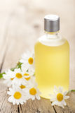 Essential oil and chamomile flowers Royalty Free Stock Photography
