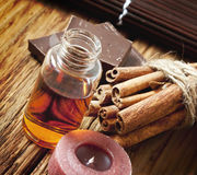 Essential Oil with Cinnamon and Chocolate Stock Photography