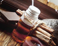 Essential Oil with Cinnamon and Chocolate Royalty Free Stock Image