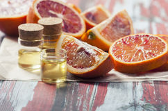 Essential oil citrus  with orange slices,  in glass bottle on ol Royalty Free Stock Photos