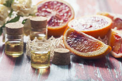 Essential oil citrus  with orange slices,  in glass bottle on ol Royalty Free Stock Images