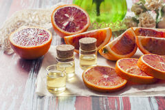 Essential oil citrus  with orange slices,  in glass bottle on ol Stock Photo